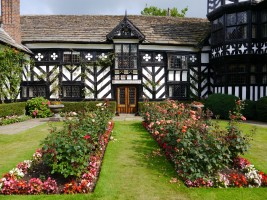 Black and white manor house and garden