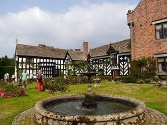 Gawsworth Hall Black and white manor house and water fountain